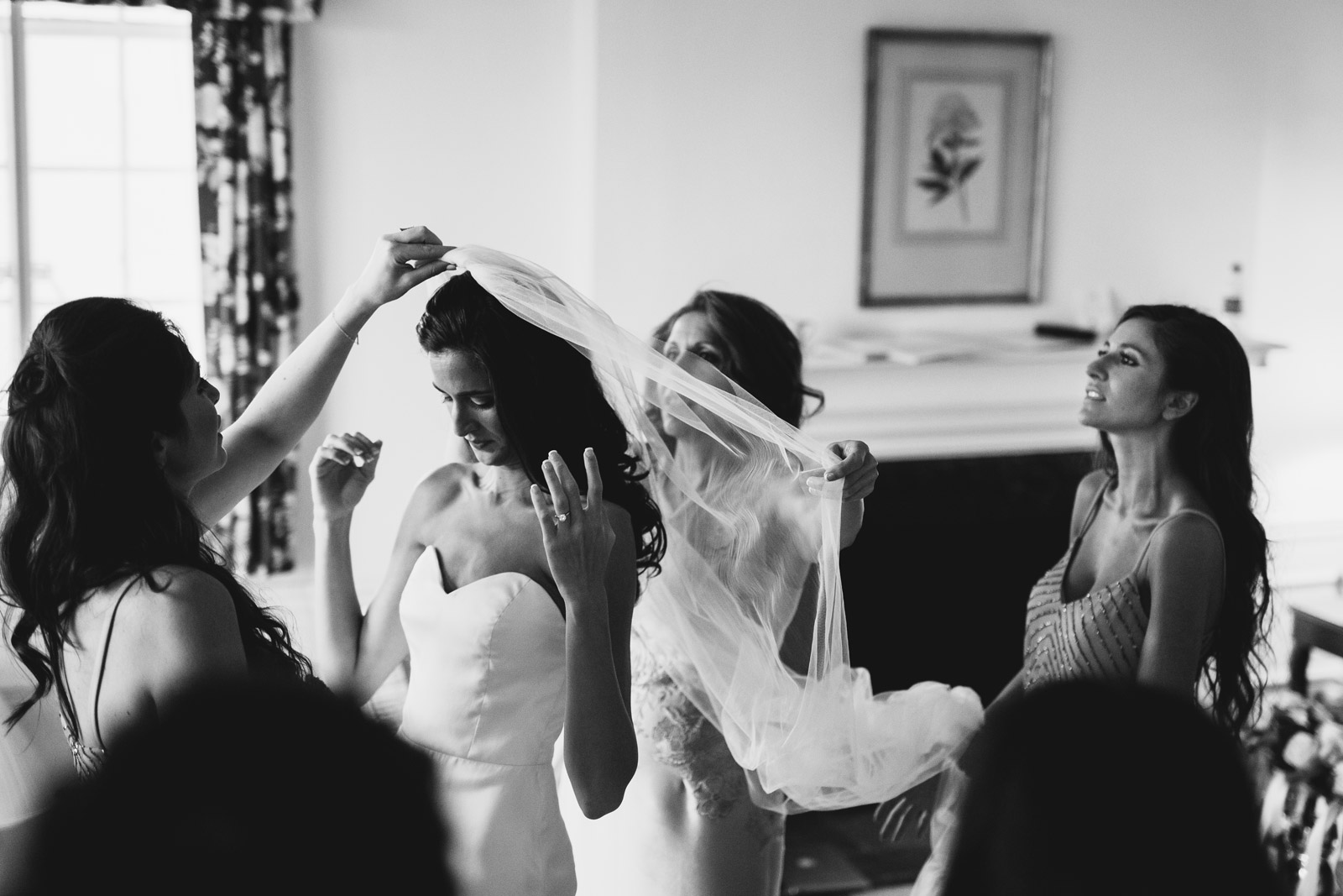 photos of mother of the bride fixing her daughters vail during the wedding day. Pictures captured by Mark Trela Photography