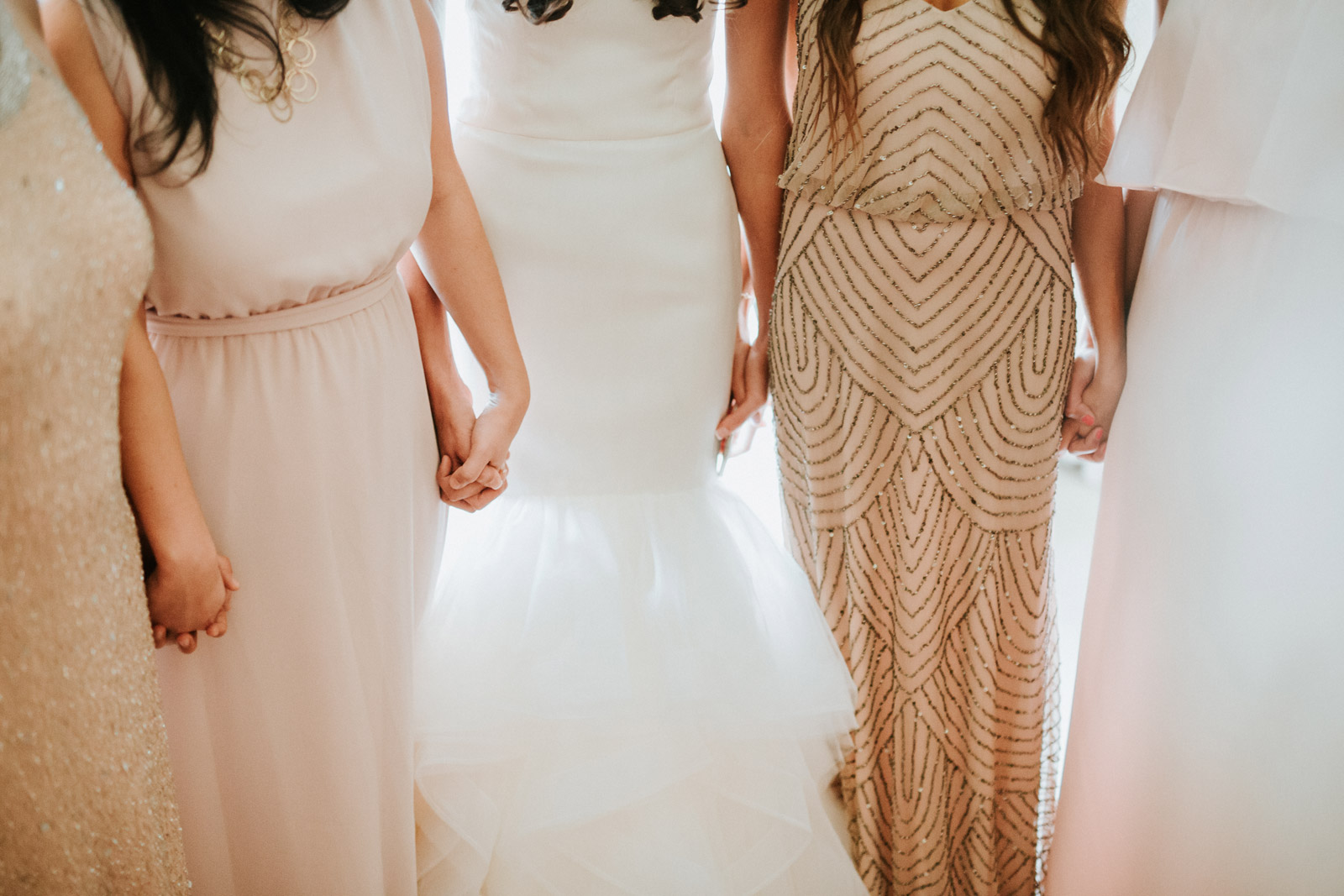 bride and her bridemaids holding hands moments before the ceremony at armour house