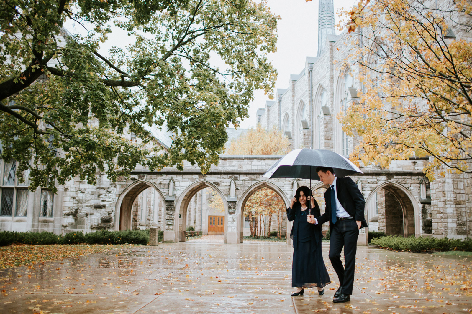 groomsman helps groom's grandmother walk during the wedding at alice millar chapel in Evanston