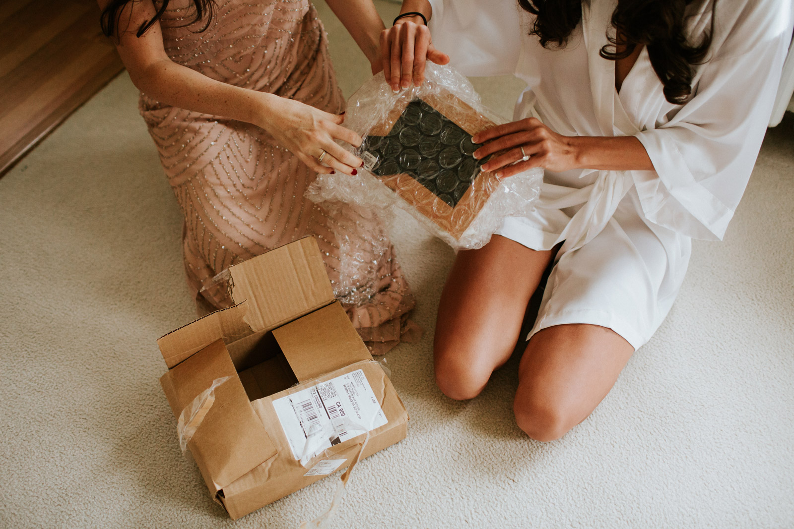 bride opening a gift from her bridesmaid during the wedding day in Chicago