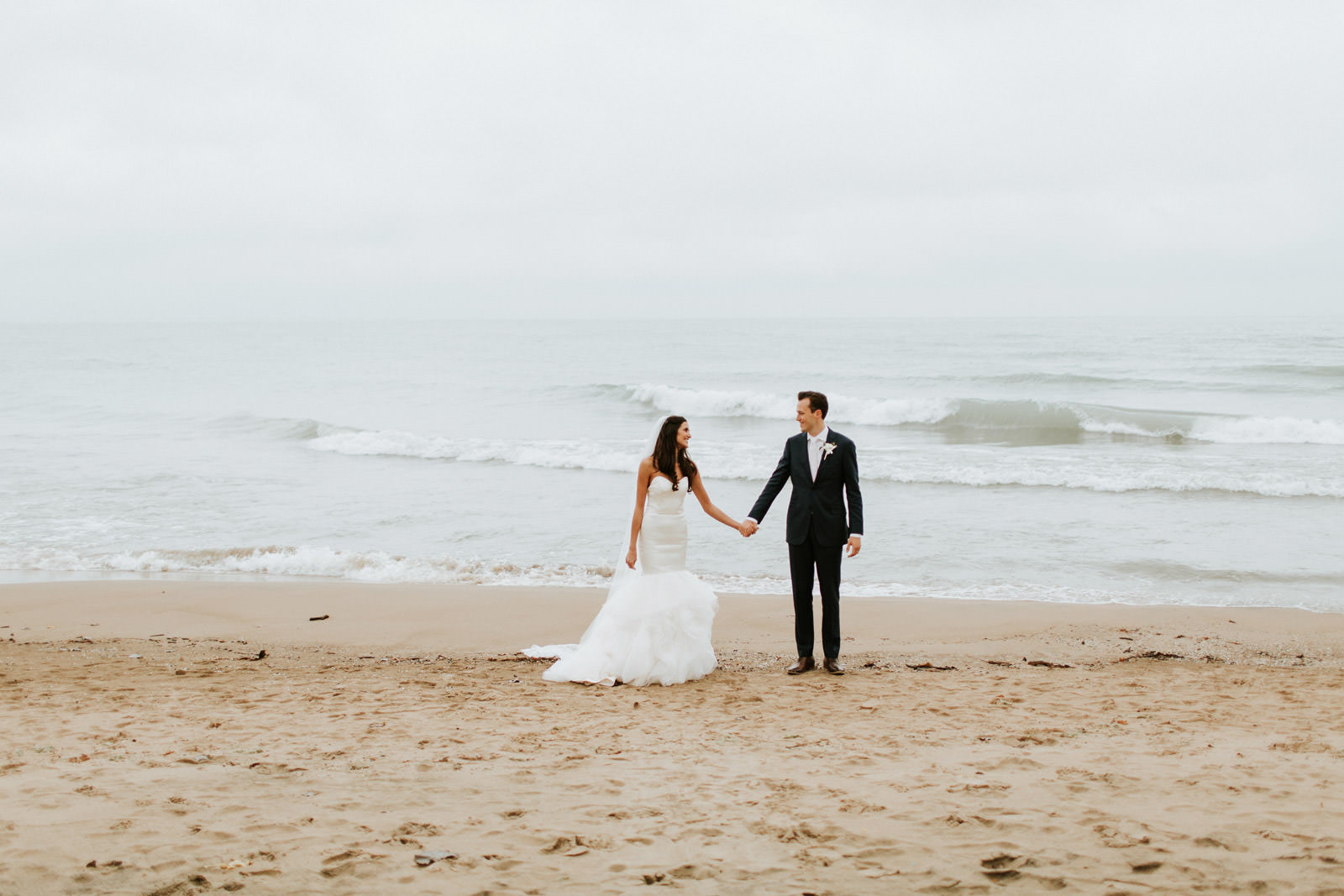 Bride and groom wedding image by lake Michigan in Evanston