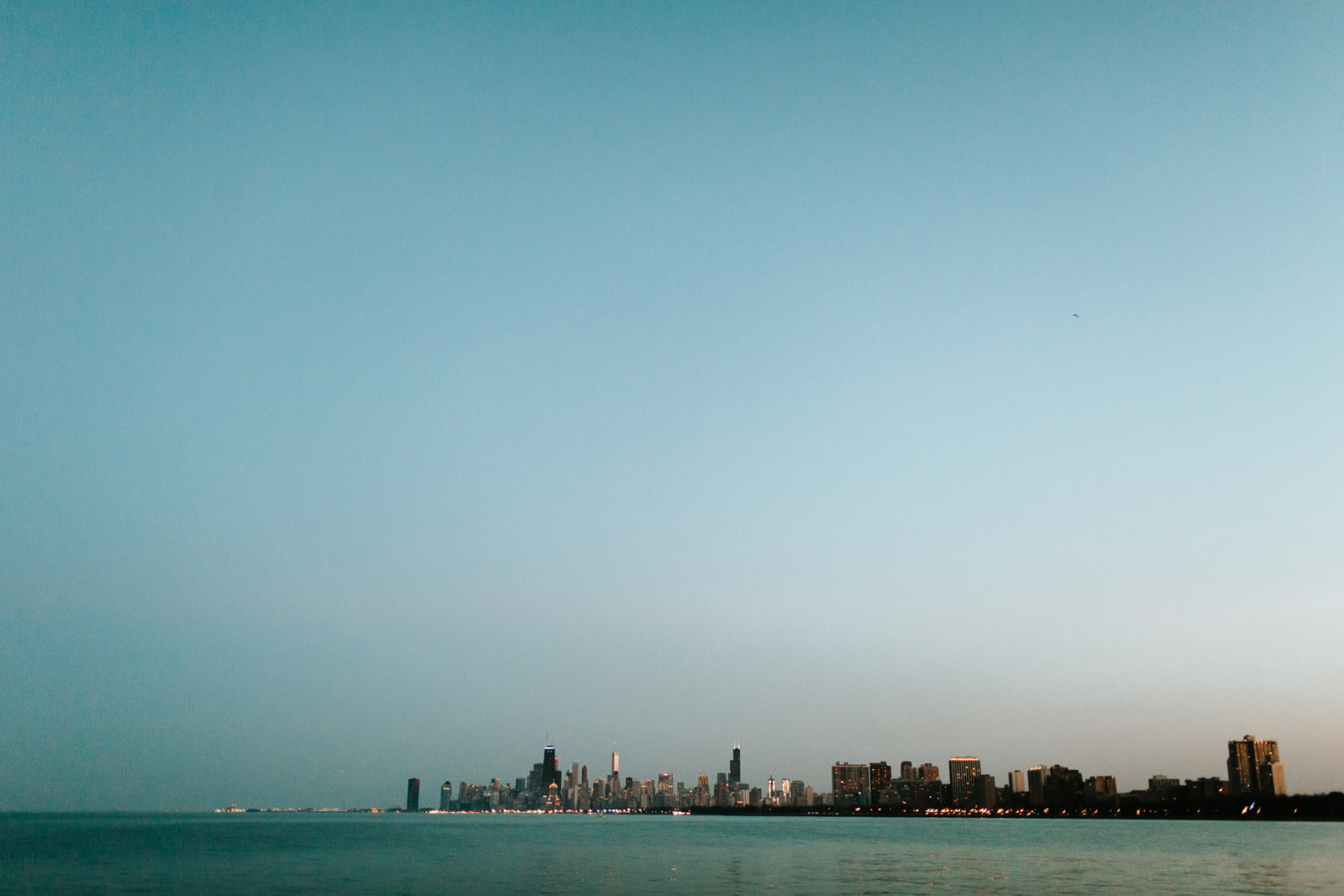 Chicago Skyline Photography Engagement Portraits by Lake Michigan