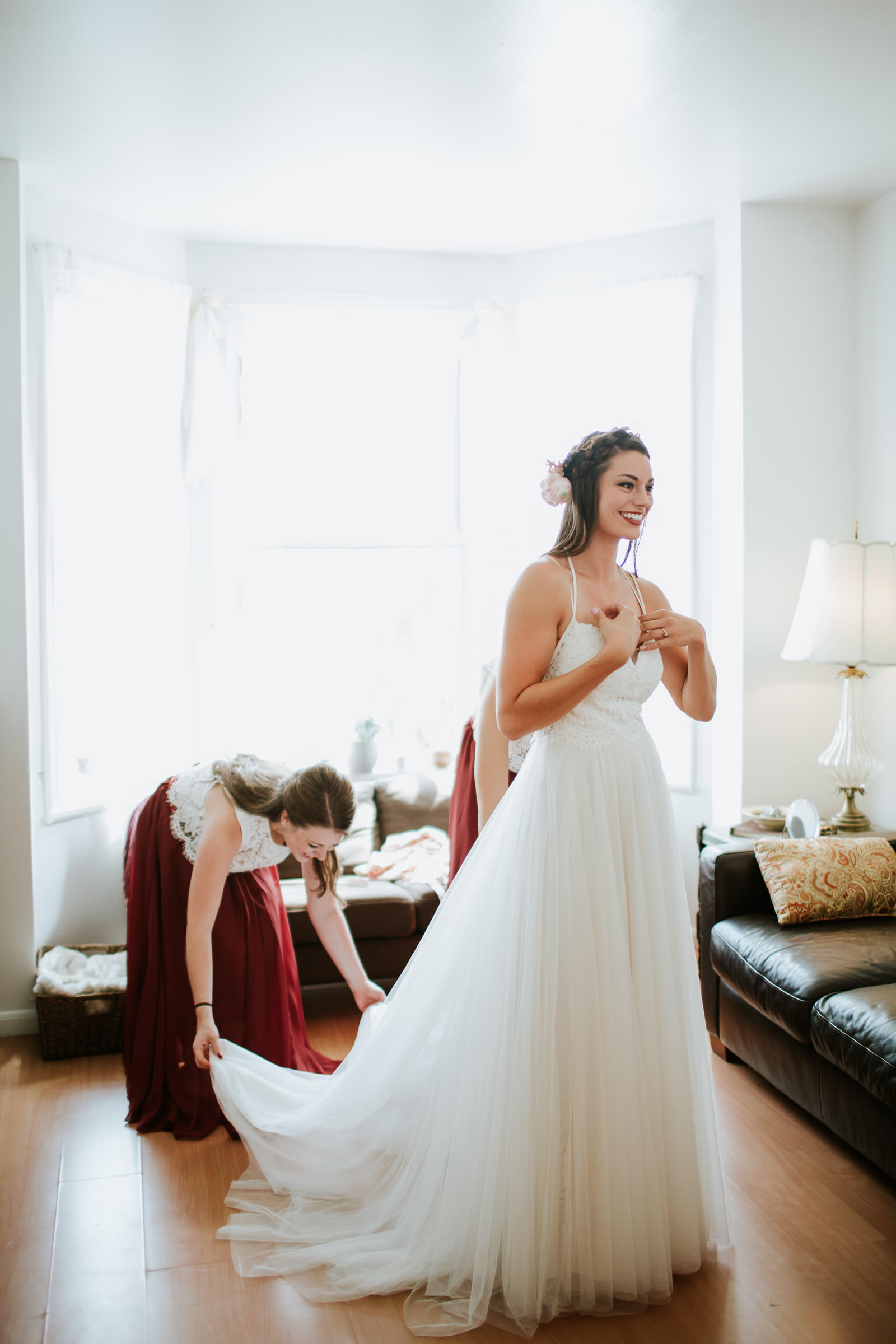 Bride putting on her BHLDN wedding dress on the wedding day in Chicago