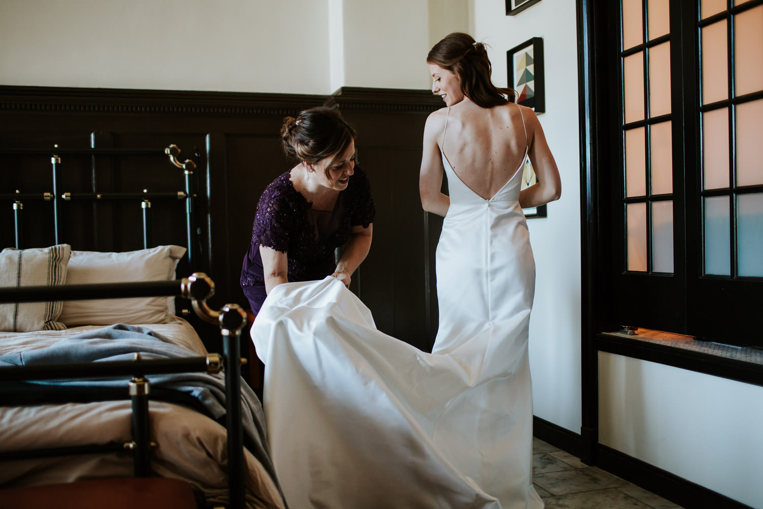 mom and daughter during the moment of putting the dress chicago athletic association hotel
