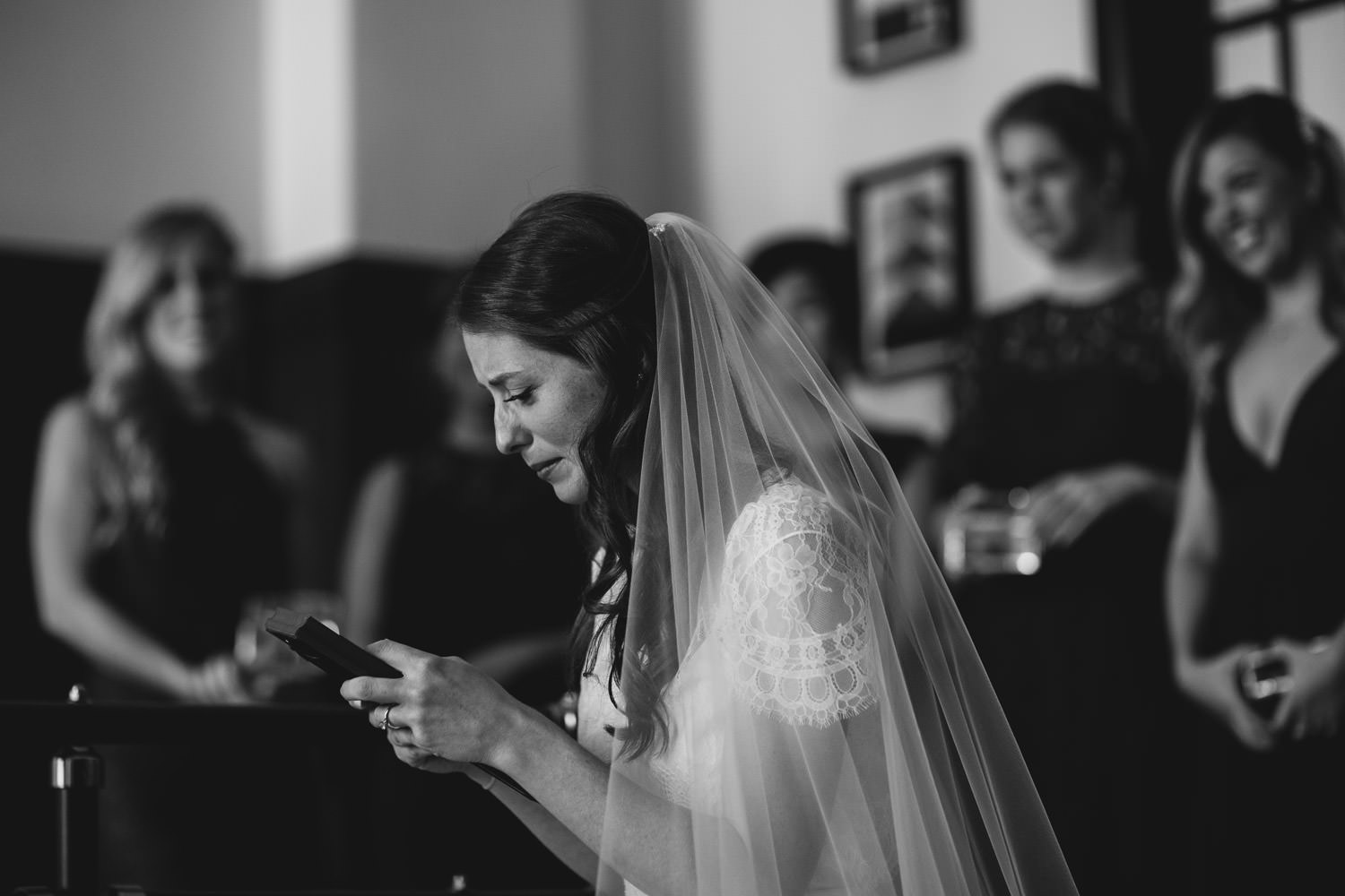 bride cries after she receives the gift from her braid maid