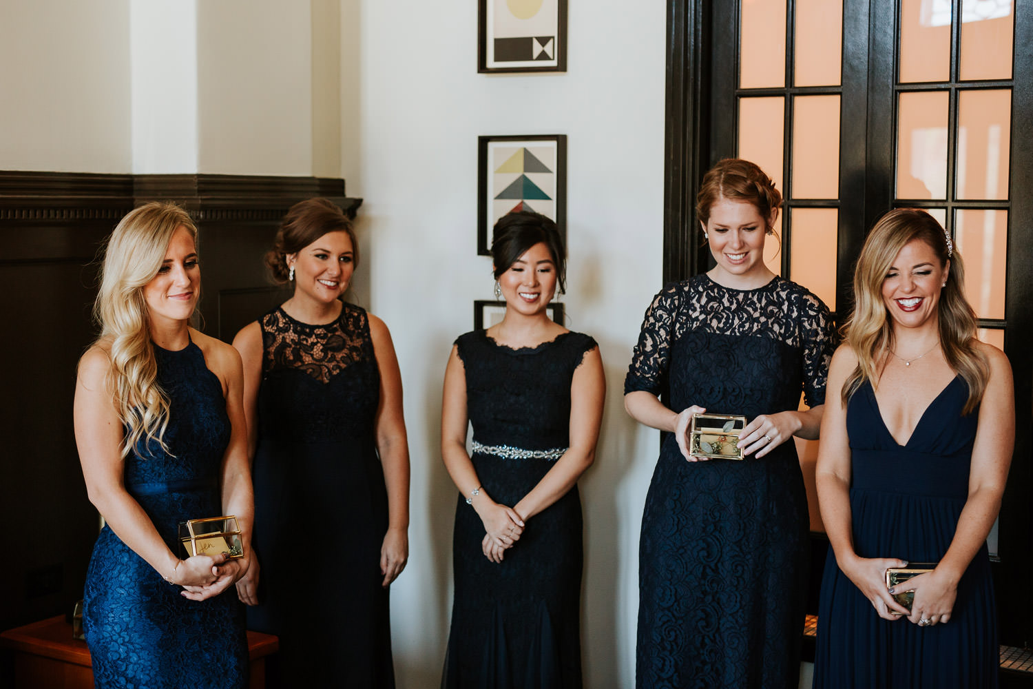 braid maids watching the bride put her wedding dress on at chicago athletic association hotel