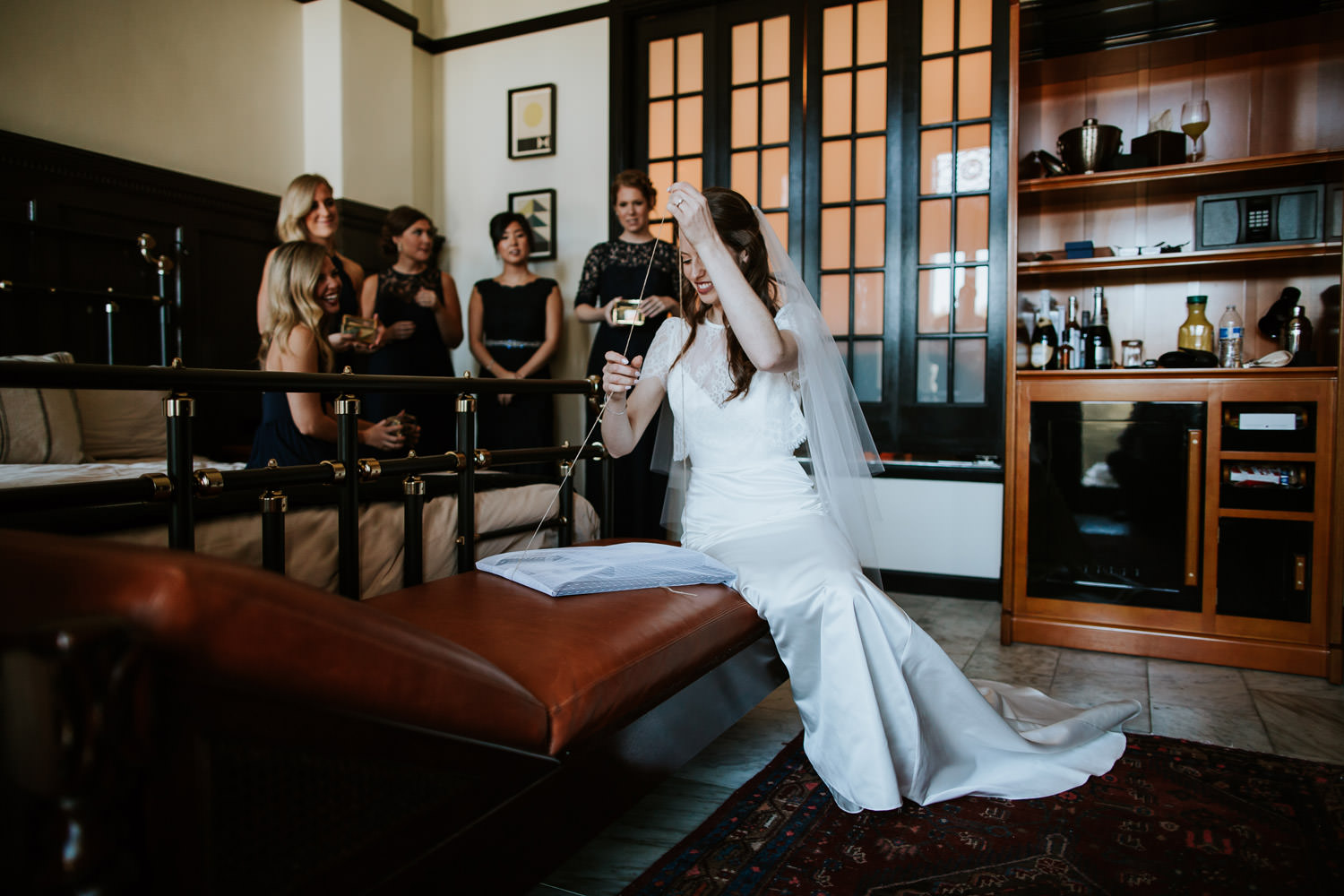 bride opening a gift at chicago athletic association hotel