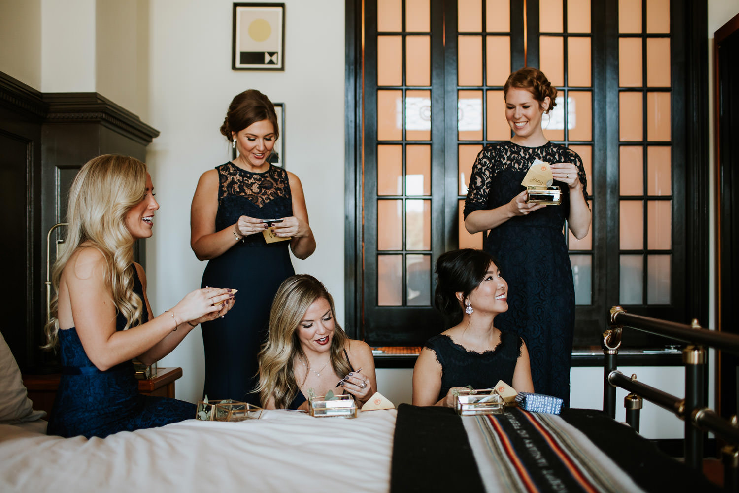barmaids receiving gift from the bride at chicago athletic association hotel wedding