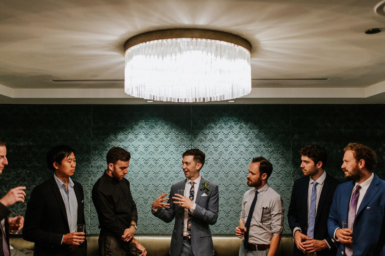 Groom men getting ready in hotel Allegro