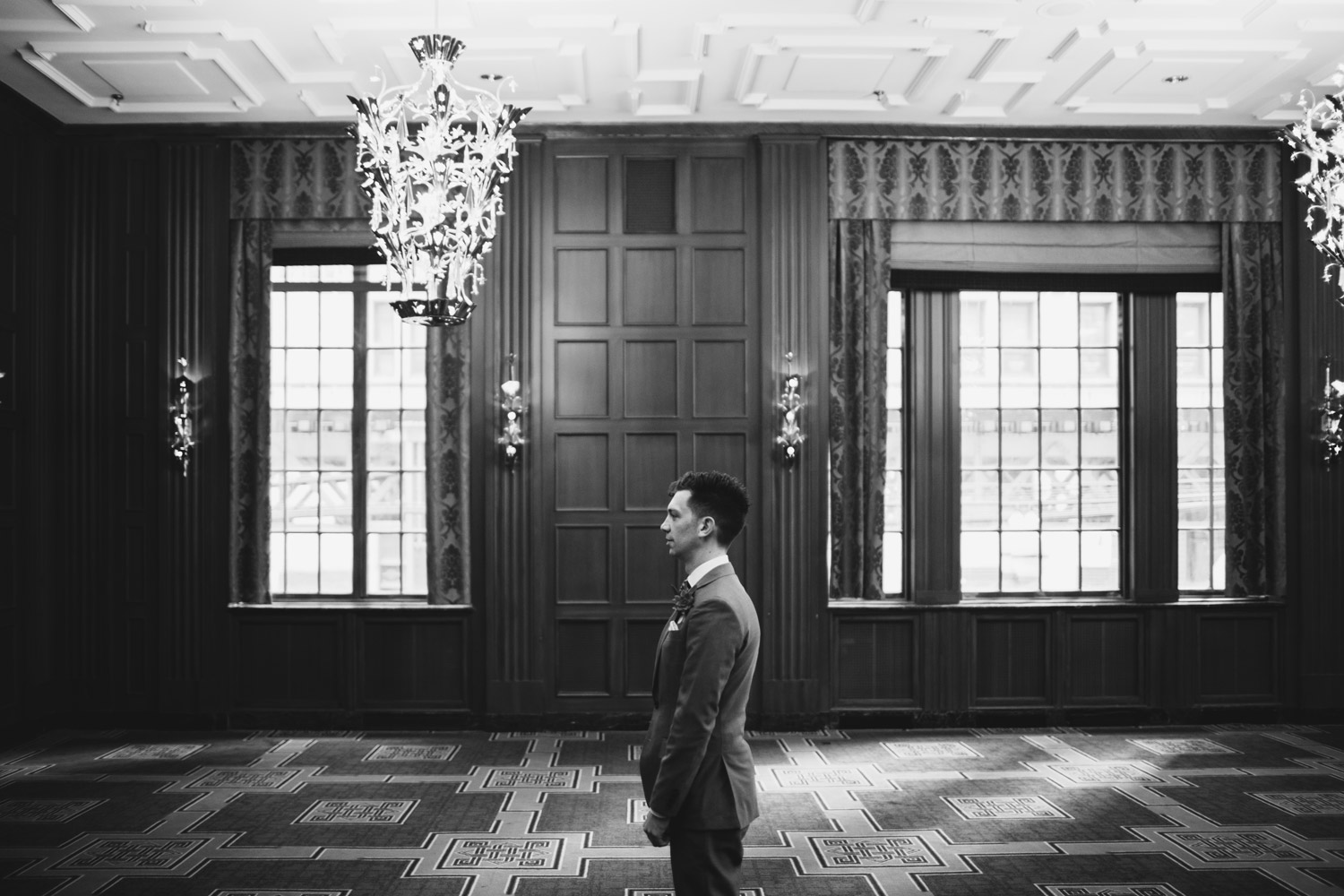 Groom waiting for the bride in hotel allegro