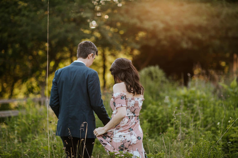Couple walking through the prairie grasses around peggy notebaert nature museum