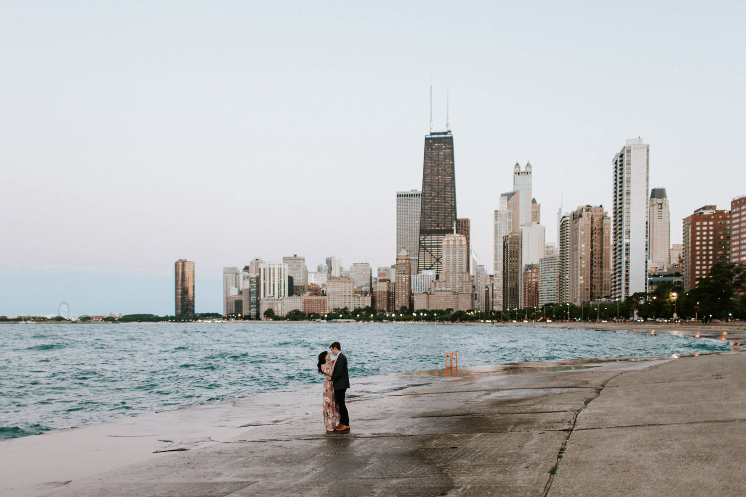 Couple photographed during their engagement session at North Ave beach in Chicago