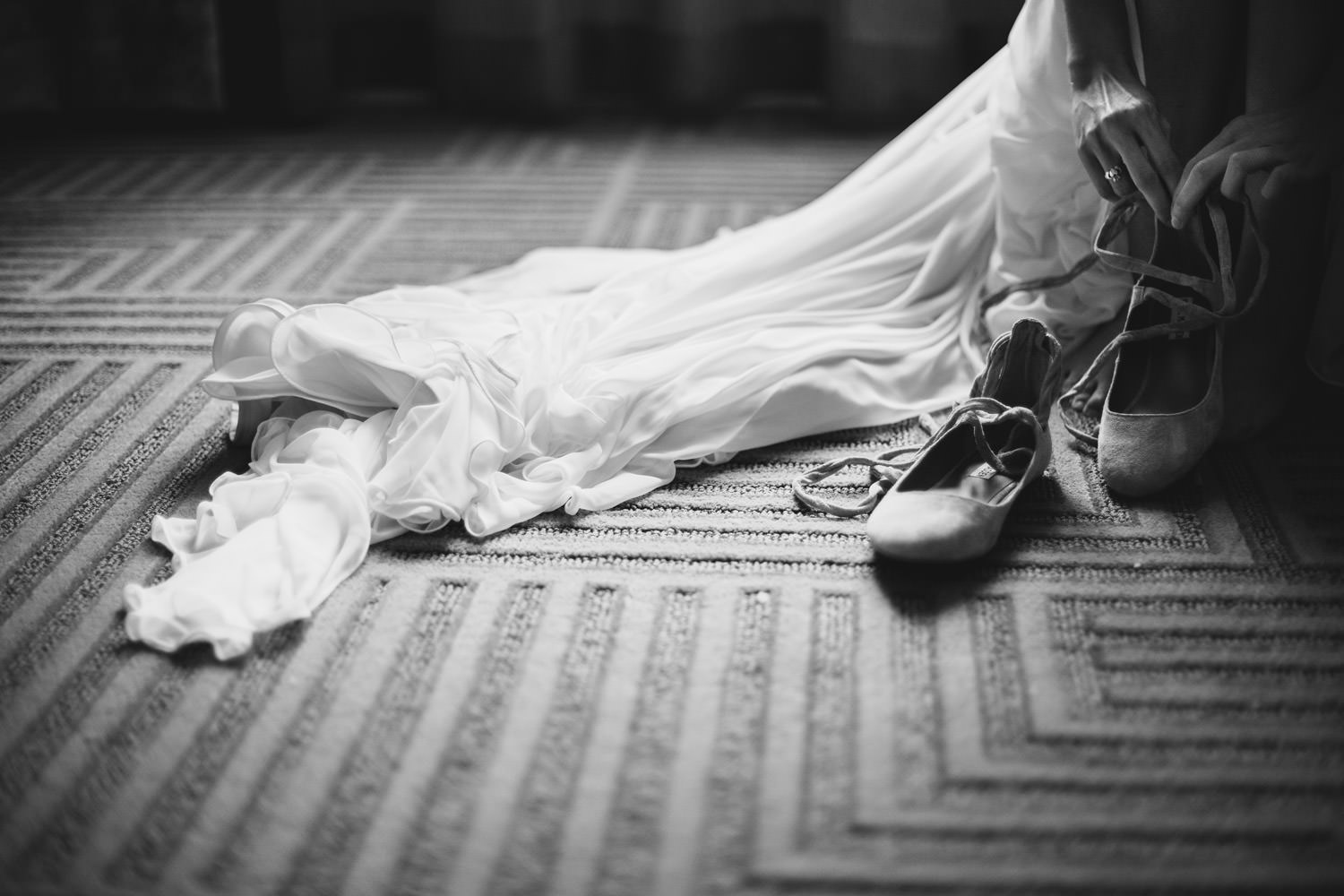 Find art picture of the bride putting on her shoes