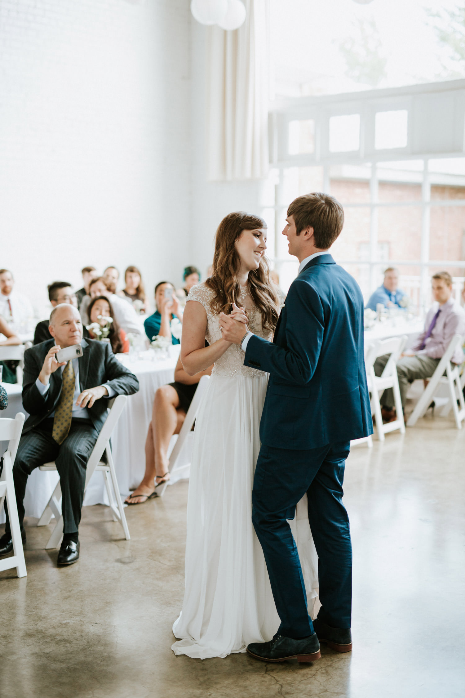 Bride and groom dance for the first time at prairie productions in Chicago