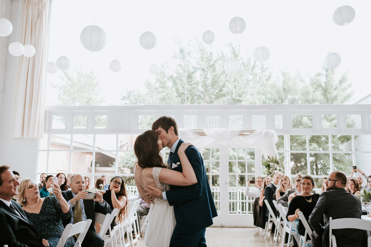 Groom kisses the bride after first dance