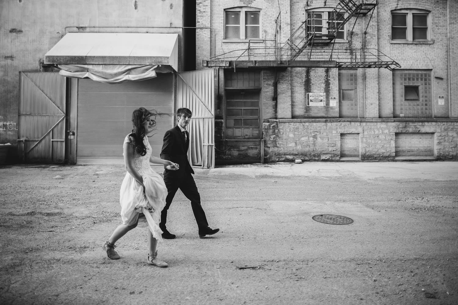 Bride and groom walking during the wedding portrait session
