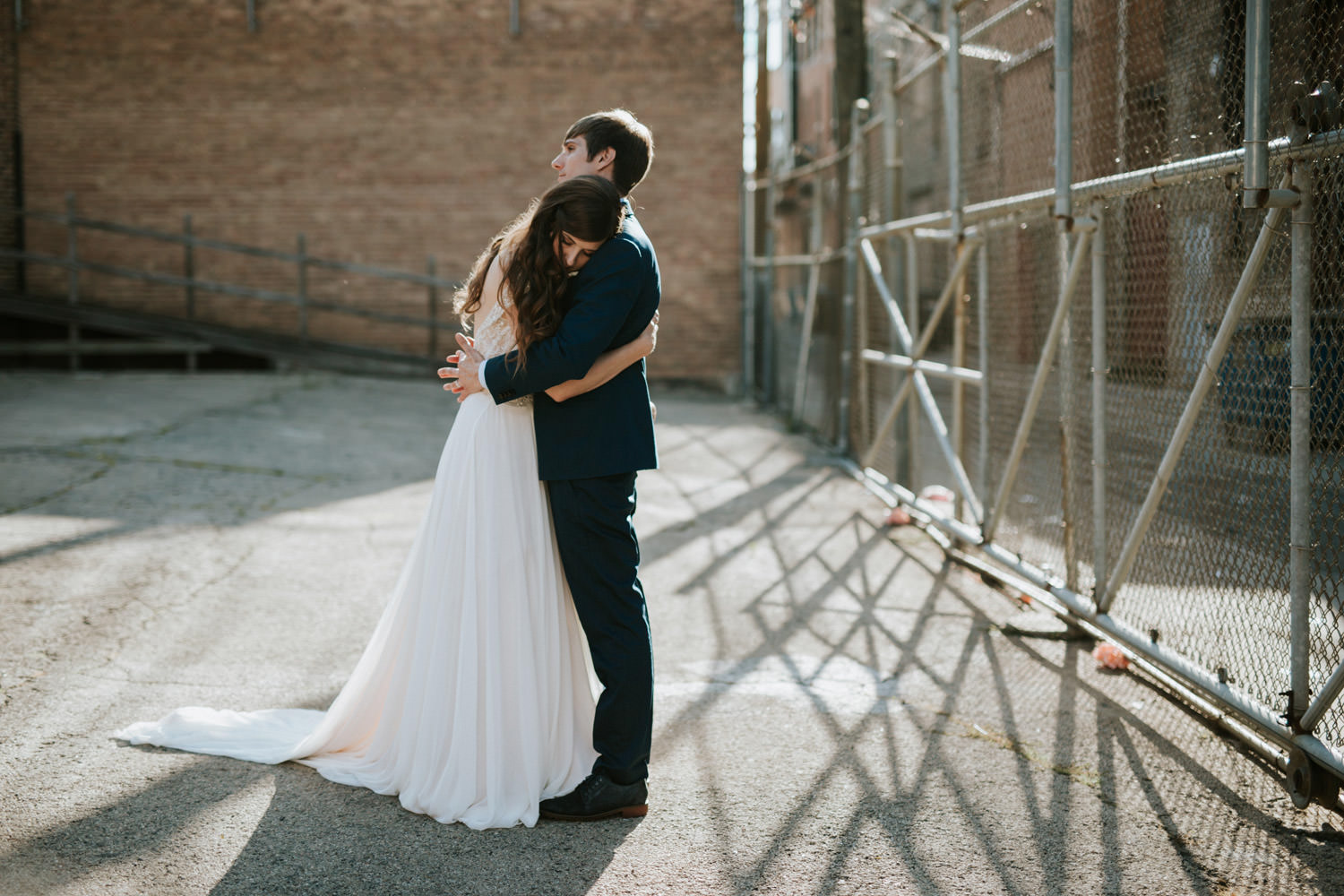 Bride and groom embrace during their wedding at west loop Chicago