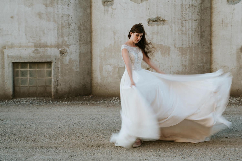 Portrait of the bride waving her dress