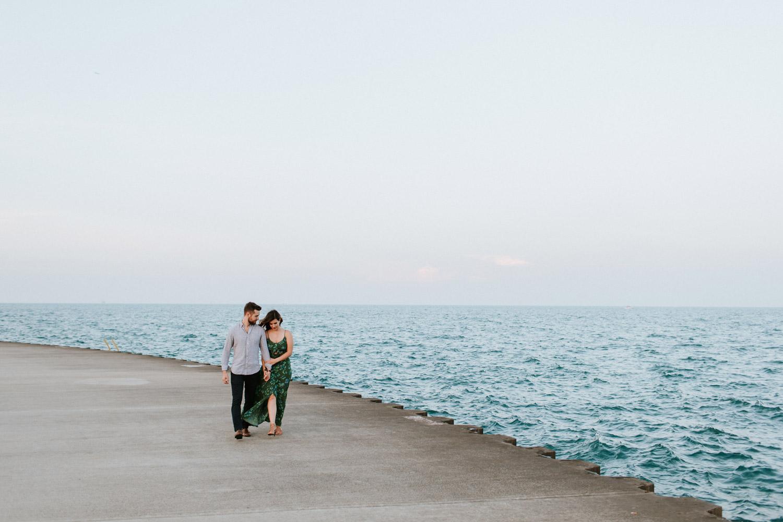 a couple walking on belmont harbor
