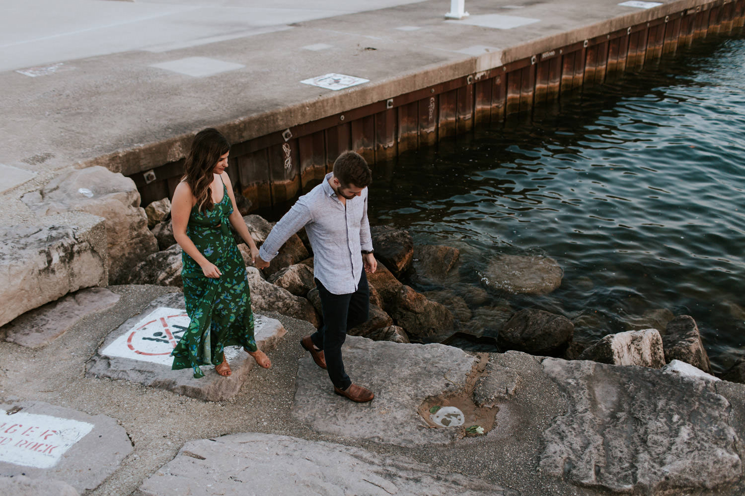 couple exporing the pier on belmont harbor in Chicago