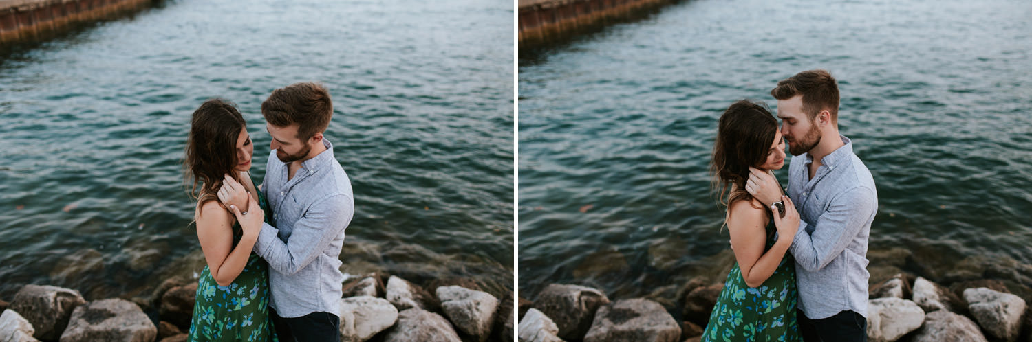 couple photographed in intimate moment during their engagement session by lake michigan in Chicago