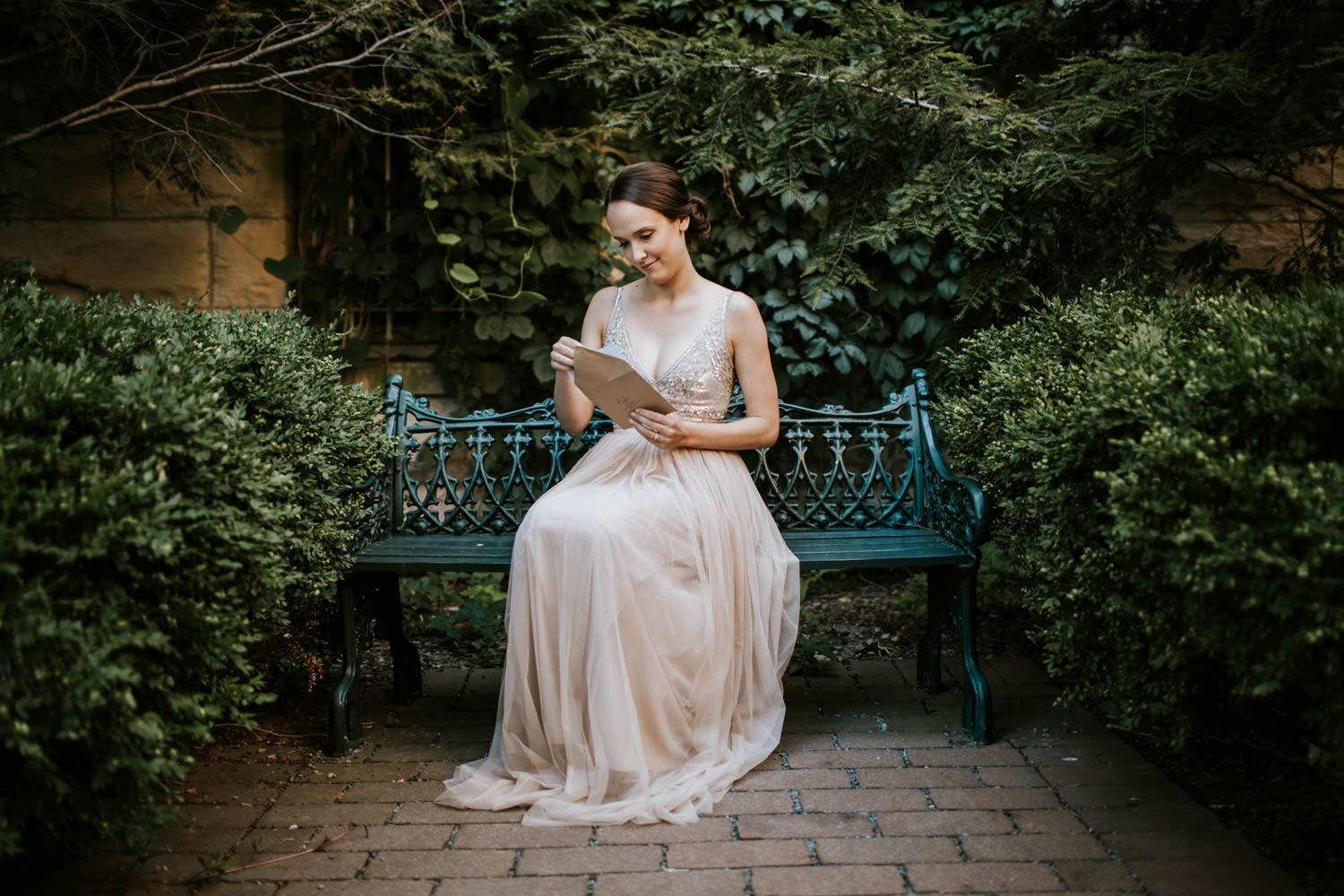Bride reading a letter from the groom at Saint Ignatius wedding. Photographed by Mark Trela photography.