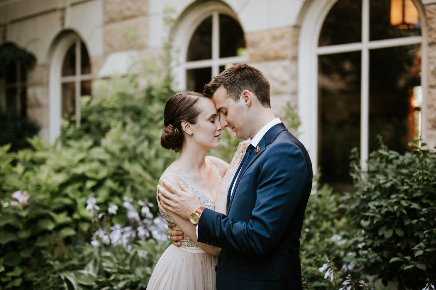 Quite moment between bride and groom captured by Mark Trela at Saint Ignatius College in Chicago