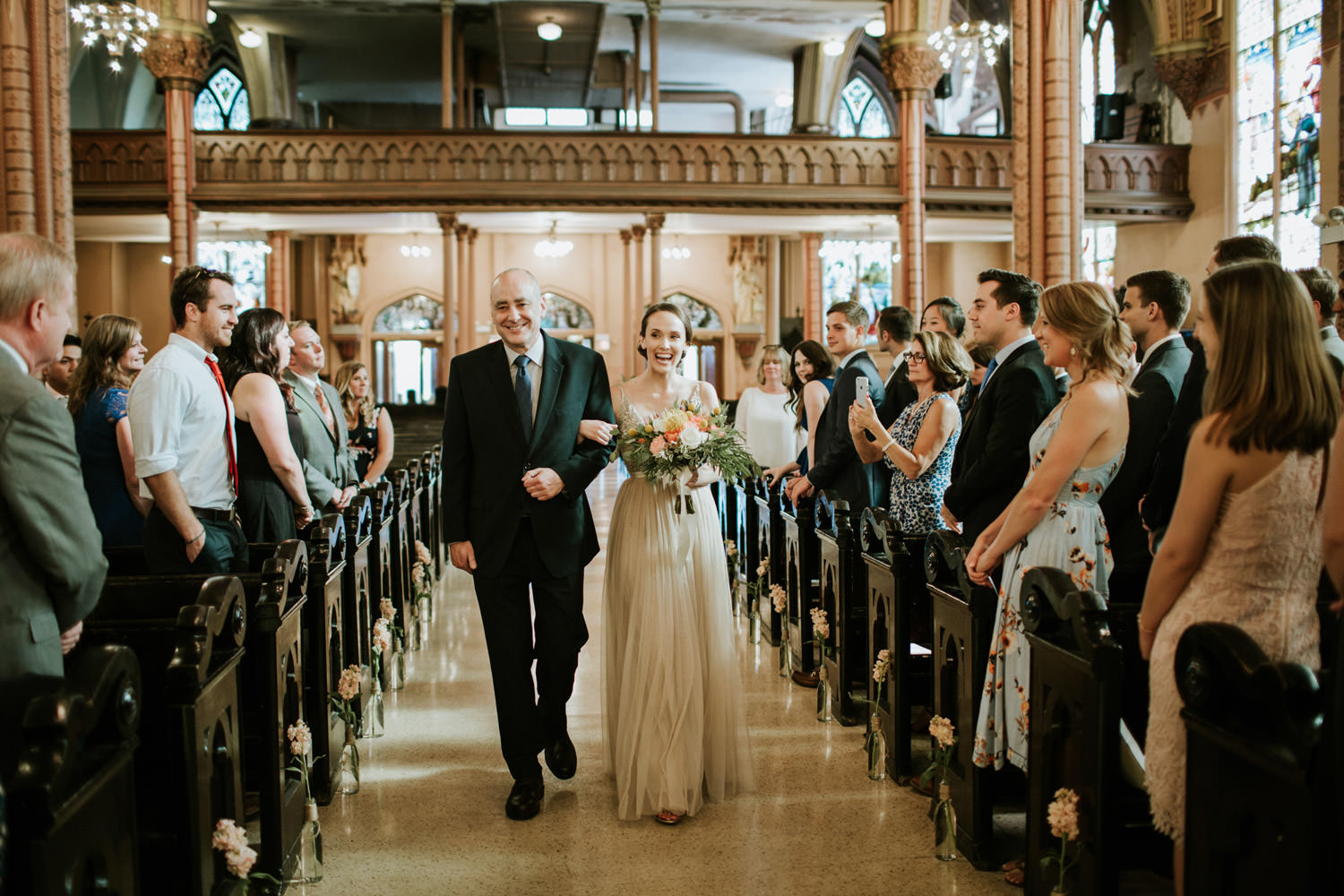 Father walking with the bride at Holy Family Catholic Church in Chicago