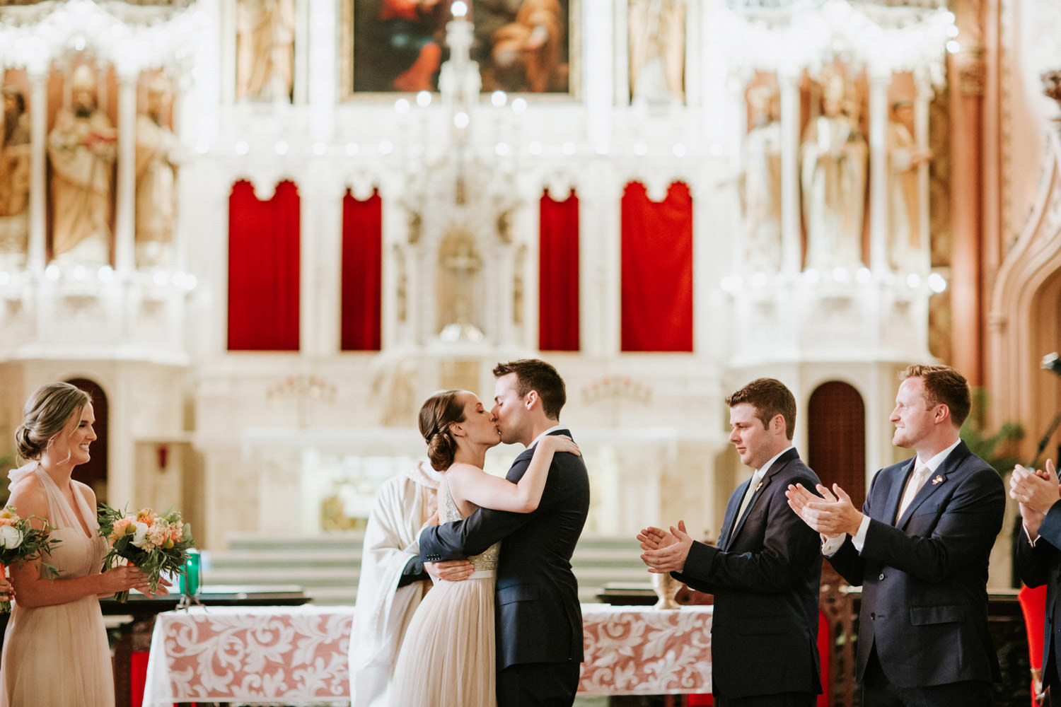 First kiss of bride and groom at Holy Family Catholic Church. Picture taken by Mark Trela