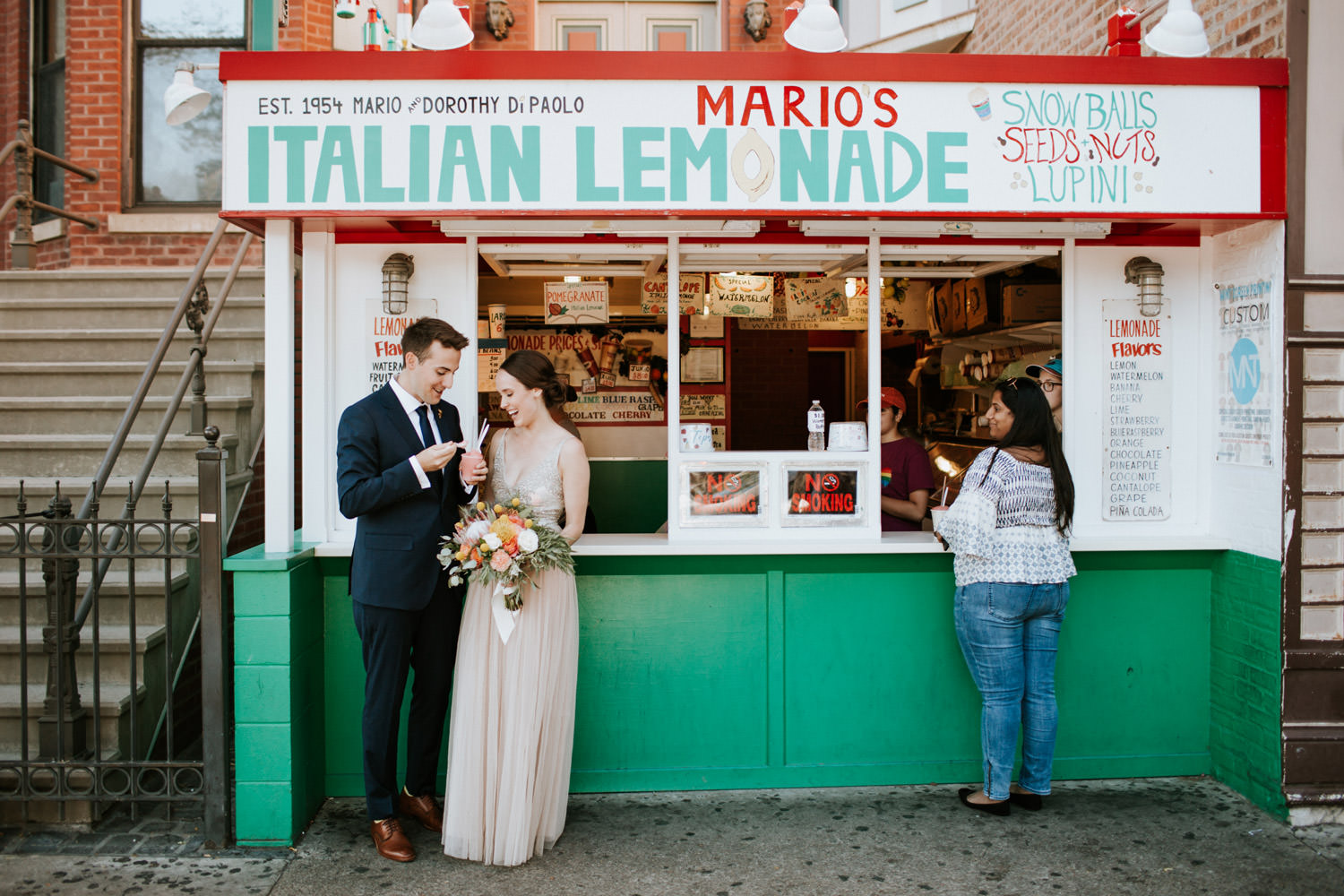 Unique Wedding picture of the bride and groom after the ceremony eating ice cream