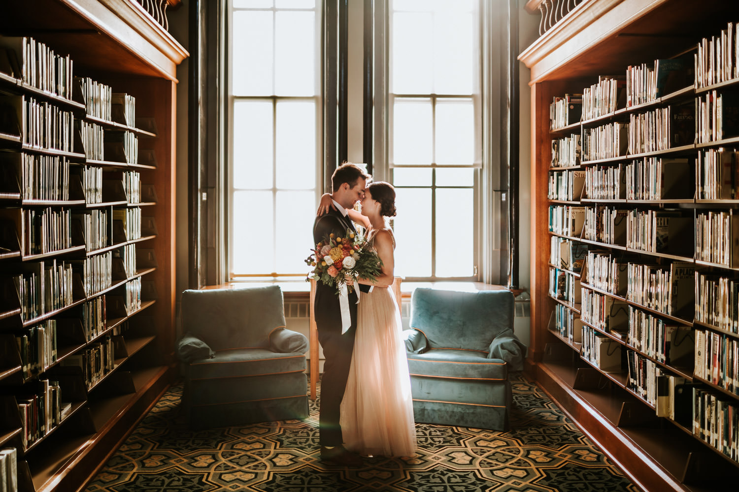 Backlit portrait of bride and groom at Saint Ignatius library. Picture taken in Chicago by Mark Trela Photography
