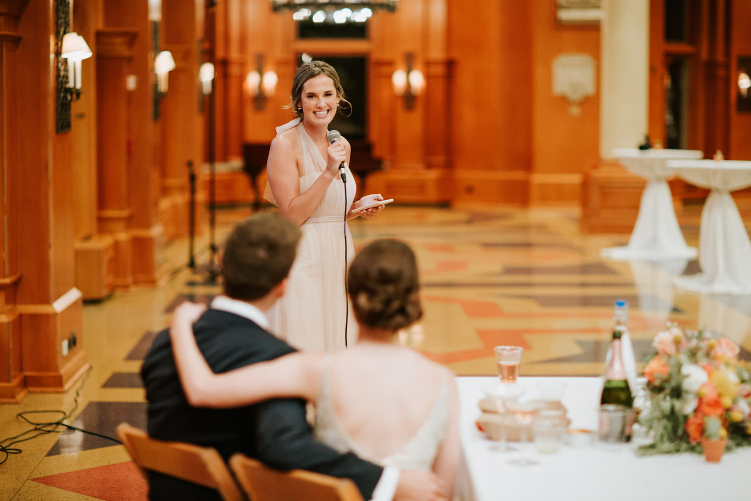 Maid of honor giving a speech during the wedding at Saint Ignatius College
