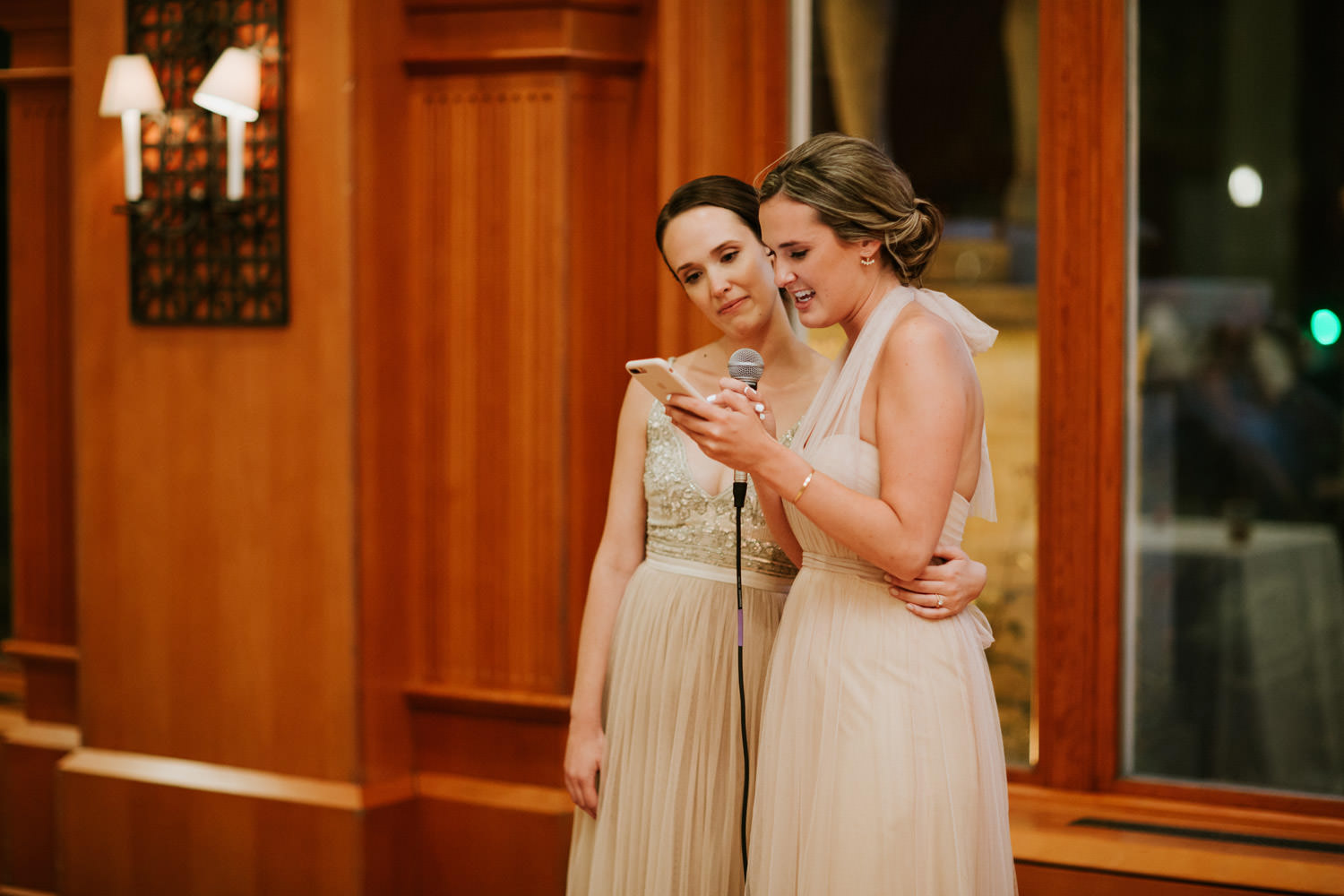 Picture of the bride embracing the maid of honor during emotional part of the speech. Photograph taken by Mark Trela