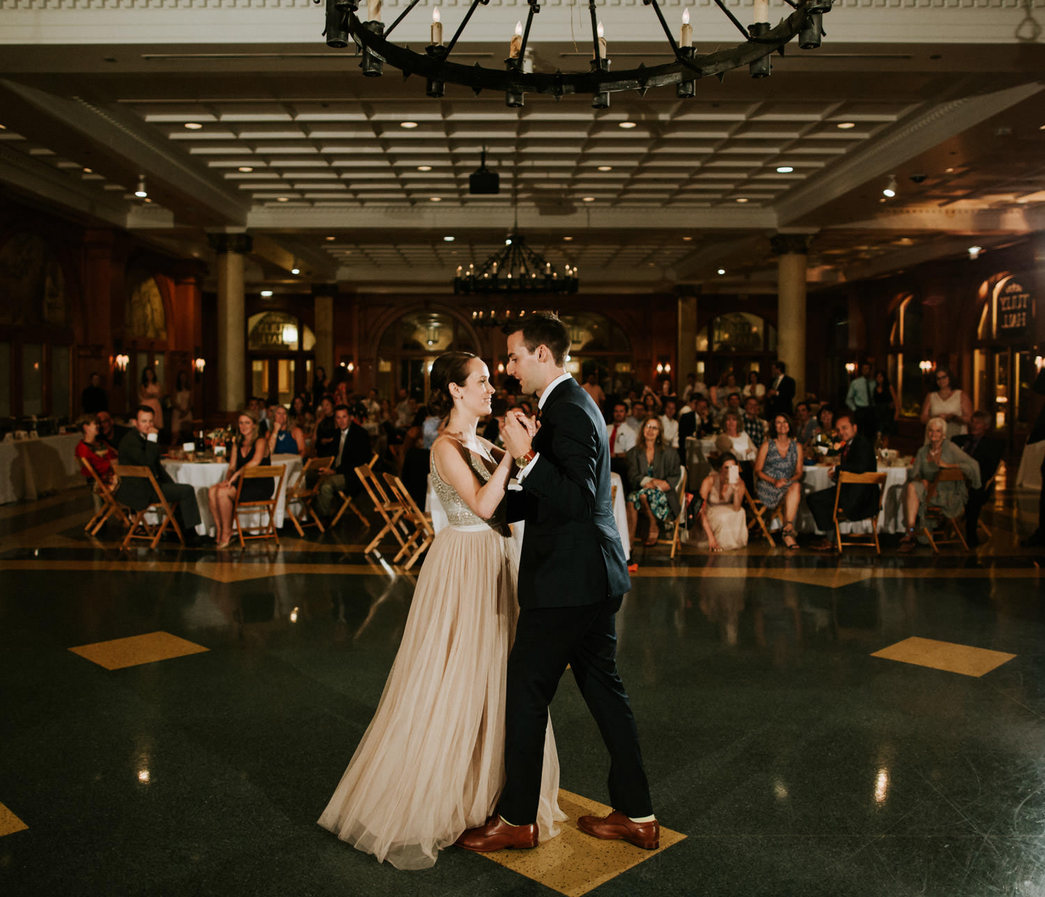 Pictures of the bride and groom dancing for the first time at Saint Ignatius College Prep