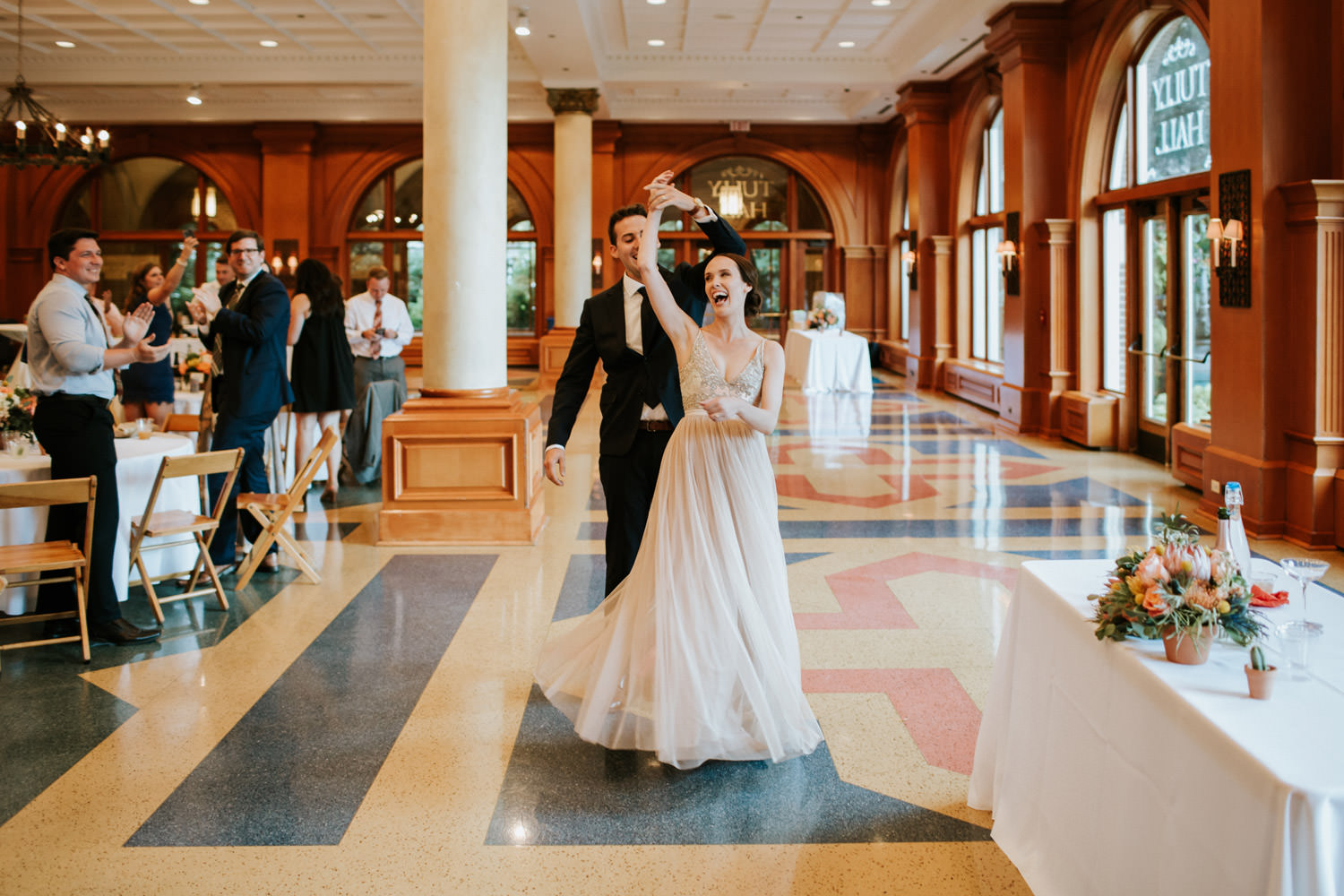 Picture of the bride and groom entering the hall during their wedding at Saint Ignatius College Prep