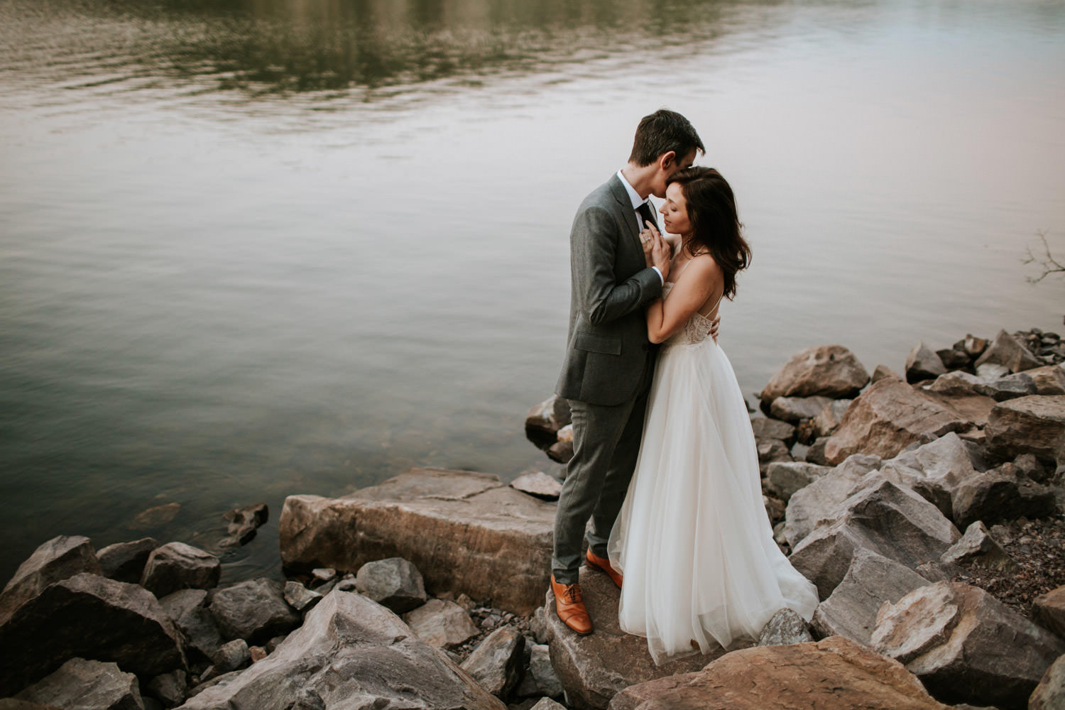 groom embraces the bride during the wedding at devil's lake state park