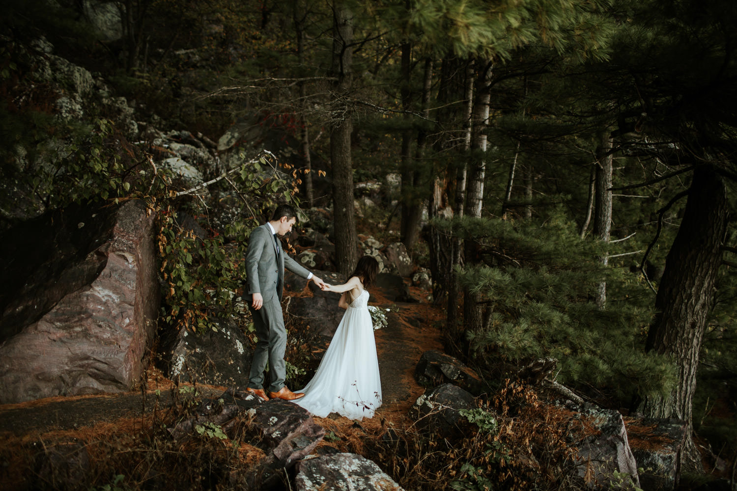 bride and groom walking in devil's lake state park on their wedding day
