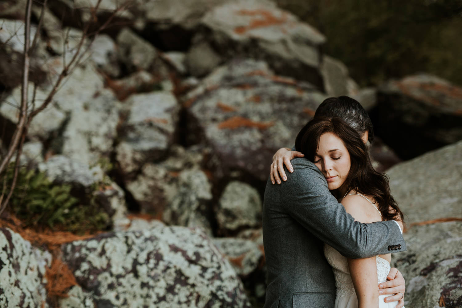 bride and groom embrace at devil's lake state park
