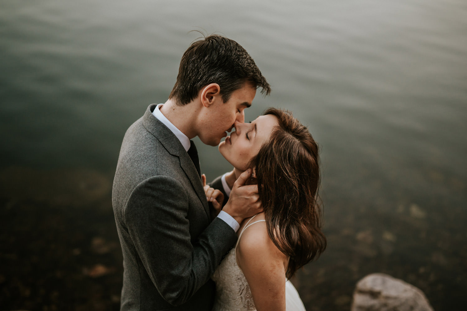 portrait of the bride and groom kissing during the wedding at the devil's lake state park