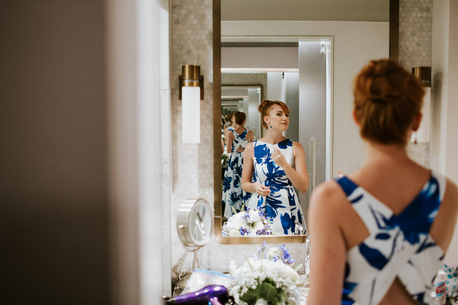bride puts a perfume during her wedding day in Chicago. Photo take ant London House hotel