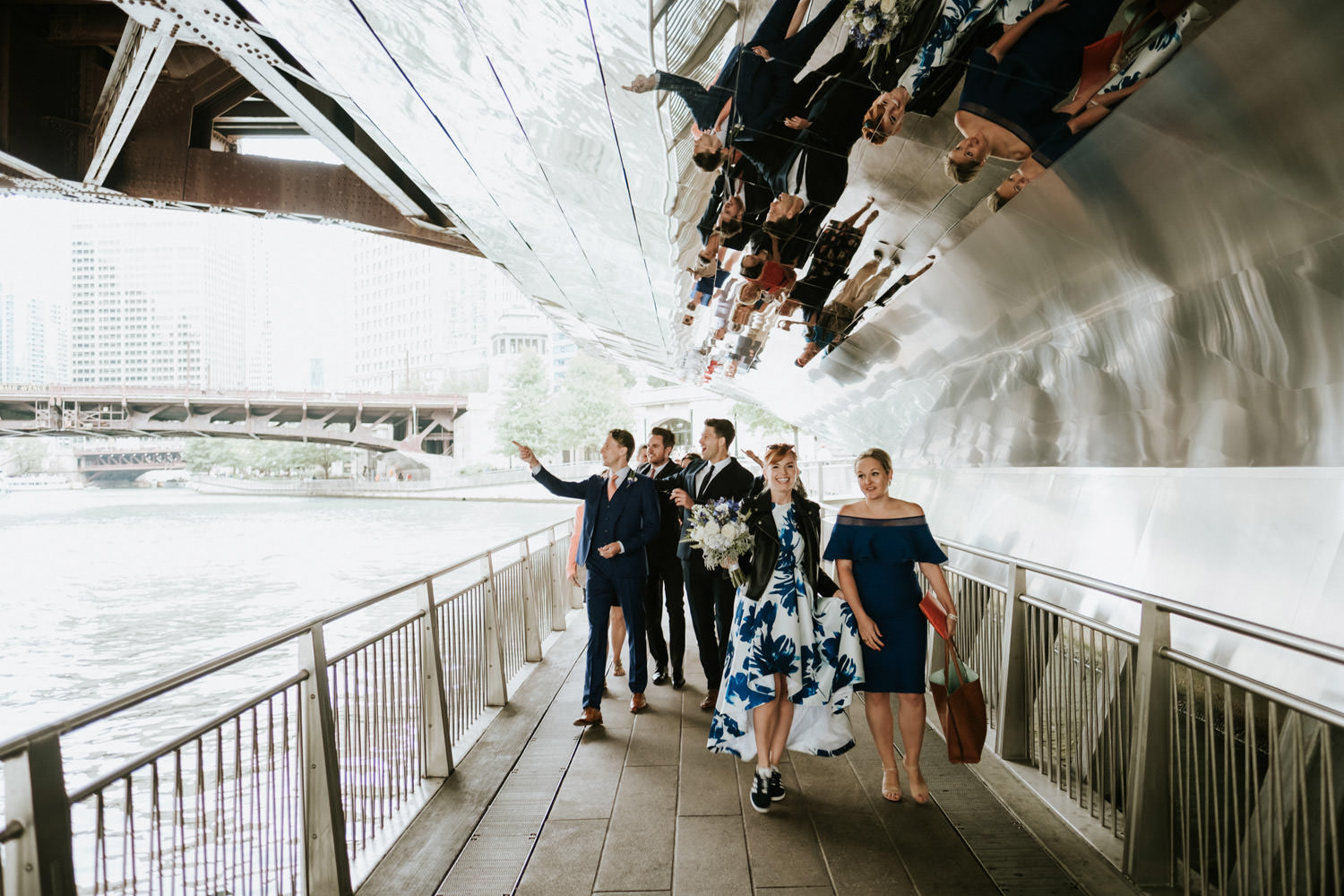 Bride and groom walk by the river walk in Chicago during their elopement