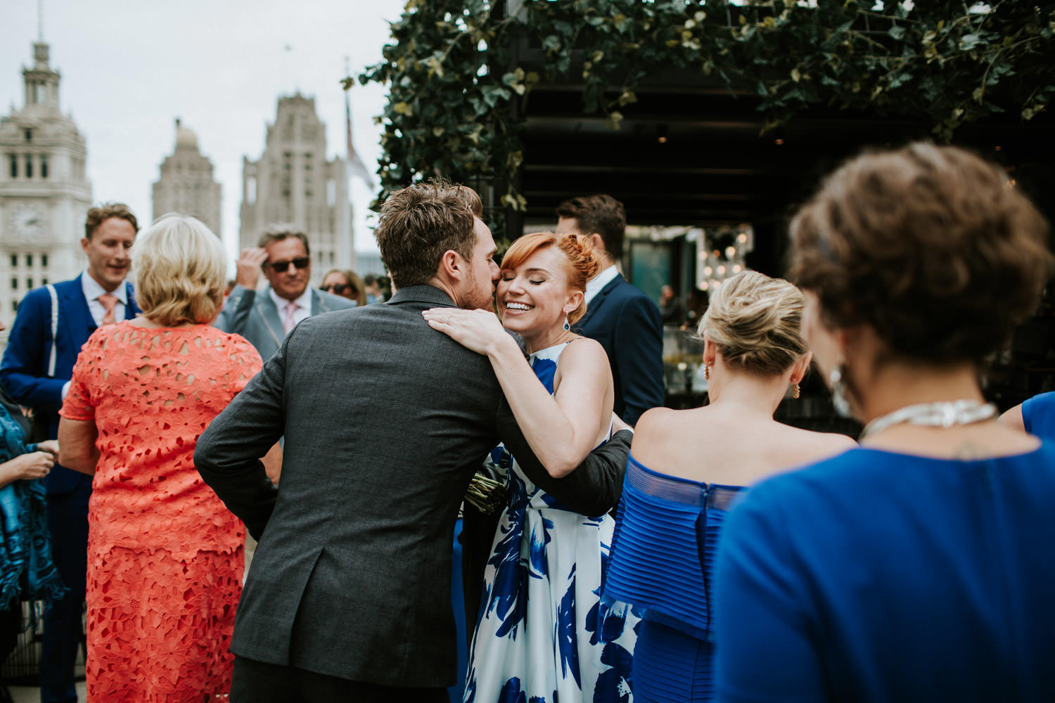 Bride embraces her family before the elopement in Chicago. Photo taken at the rooftop of London House