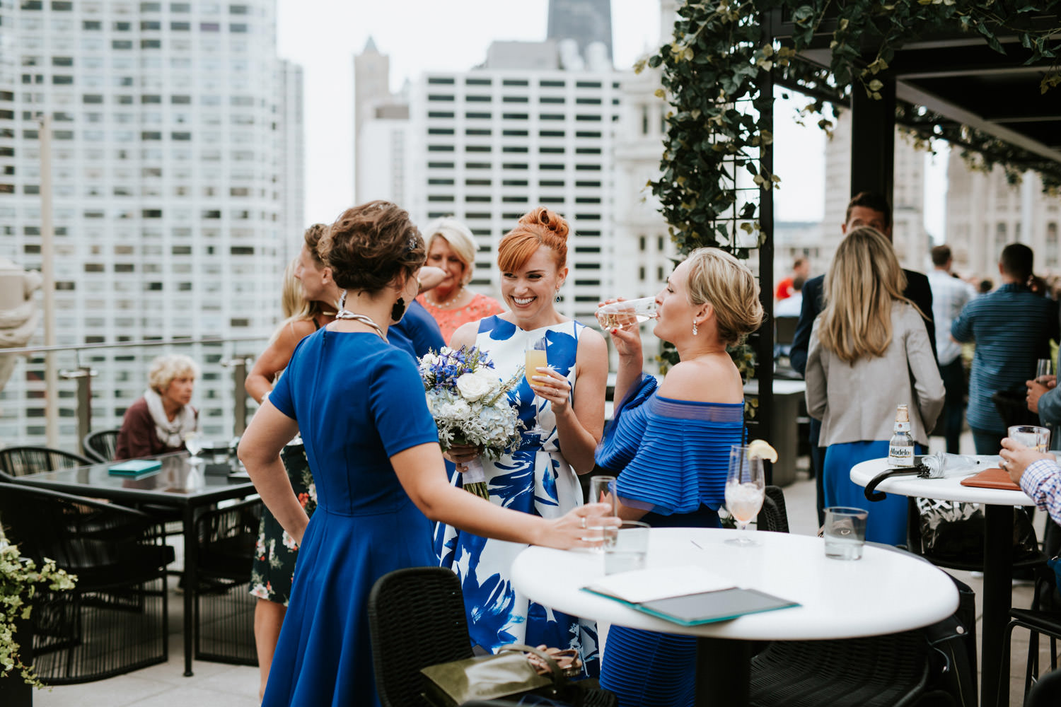 bride mingles with bride maids at rooftop of london house in chicago