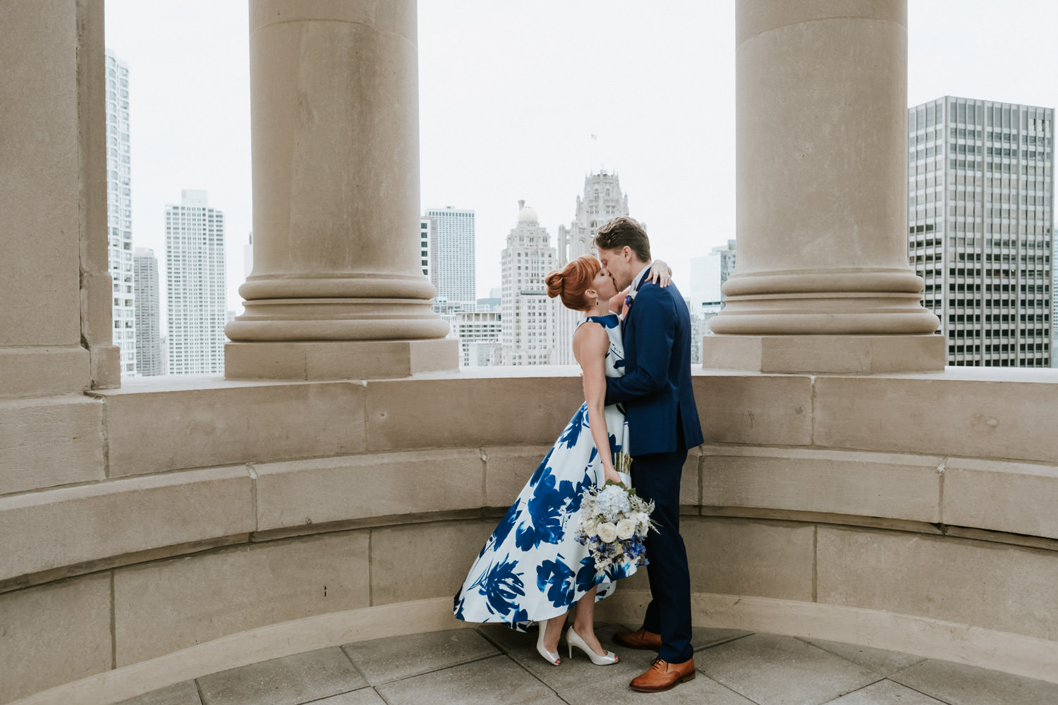 Bride and groom kiss at the roof top of London house in Chicago, moments before their elopement.
