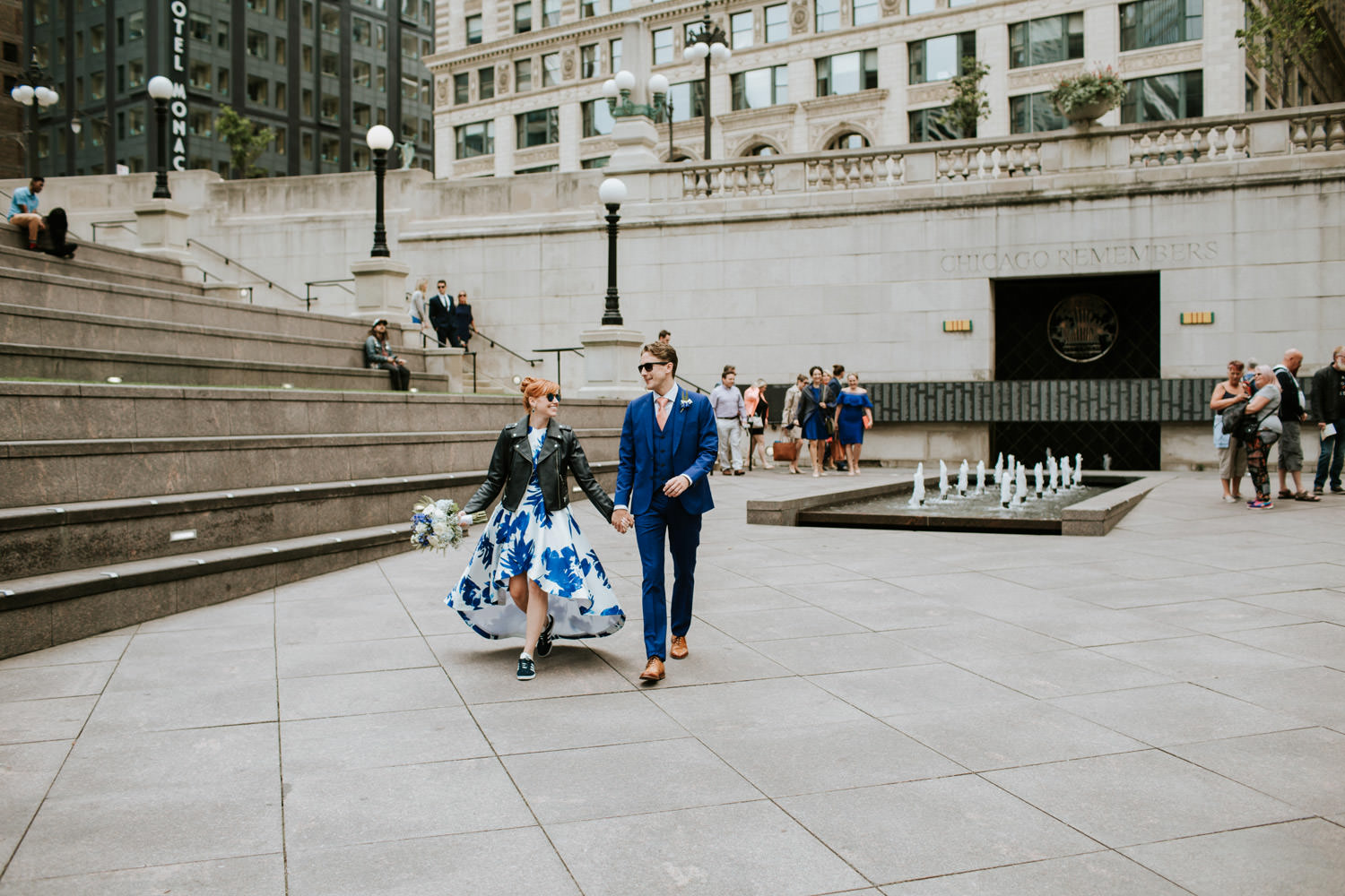Chicago elopement photographer captures bride and groom walking in downtown