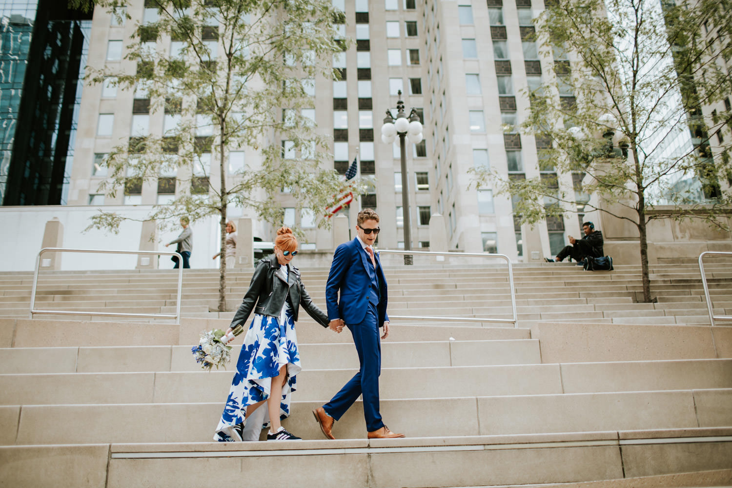 bride and groom walk in downtown Chicago during their elopement day