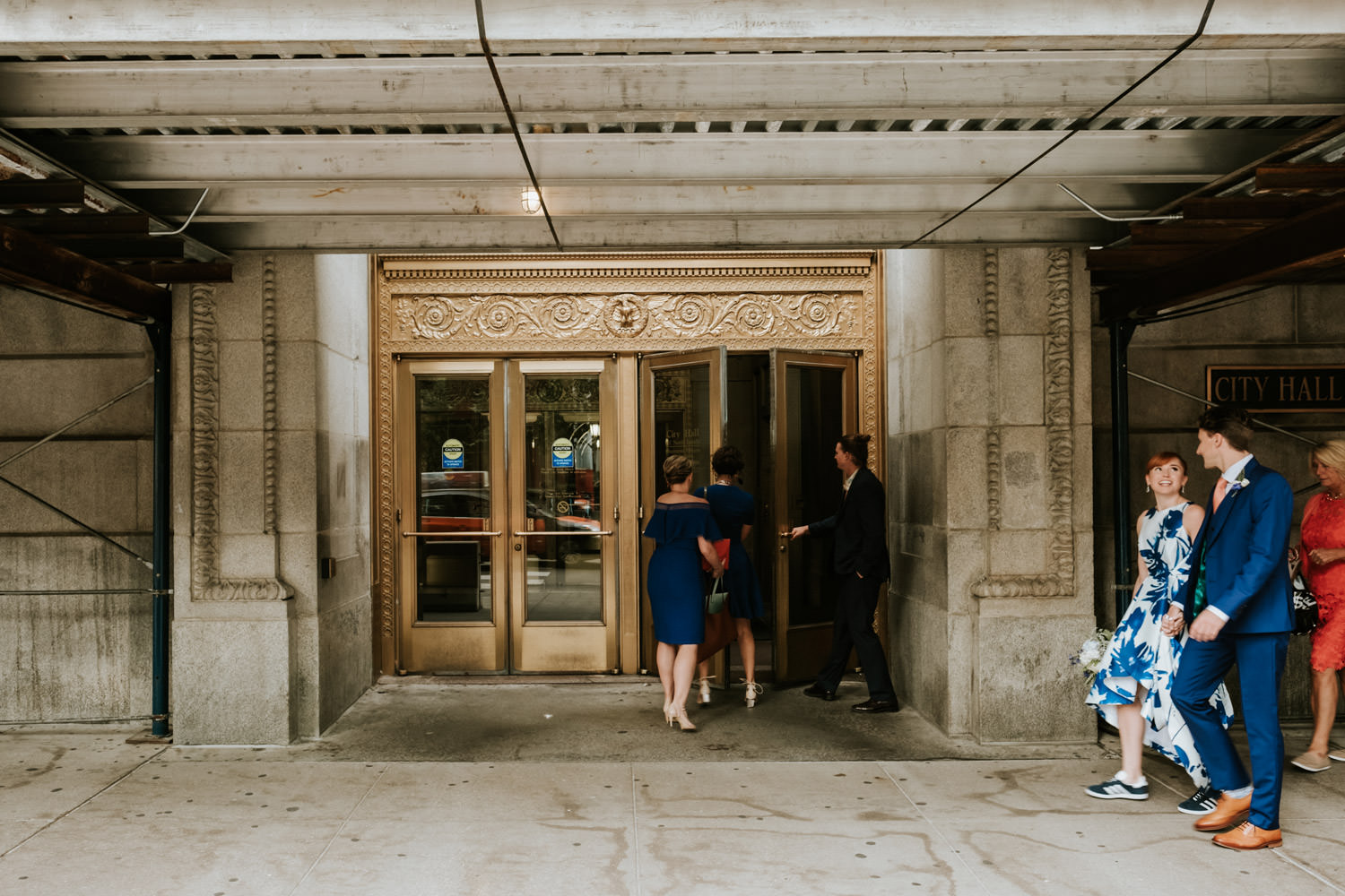 Bride and groom walk to the civil court in Chicago during their elopement