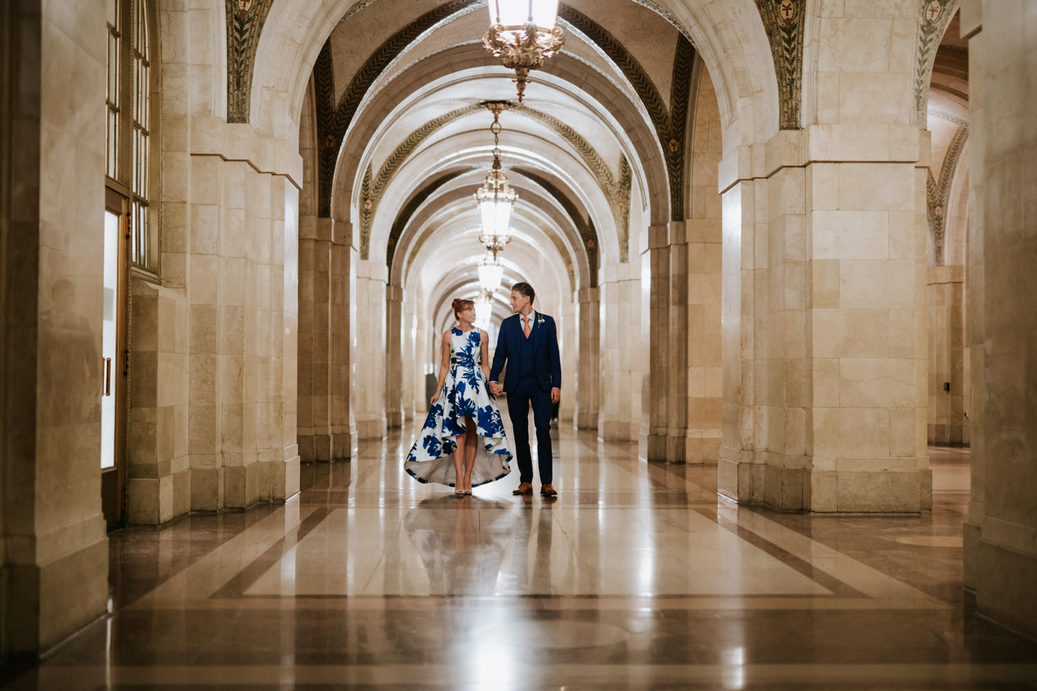 bride the groom walk in the Chicago Civil court during their October Elopement