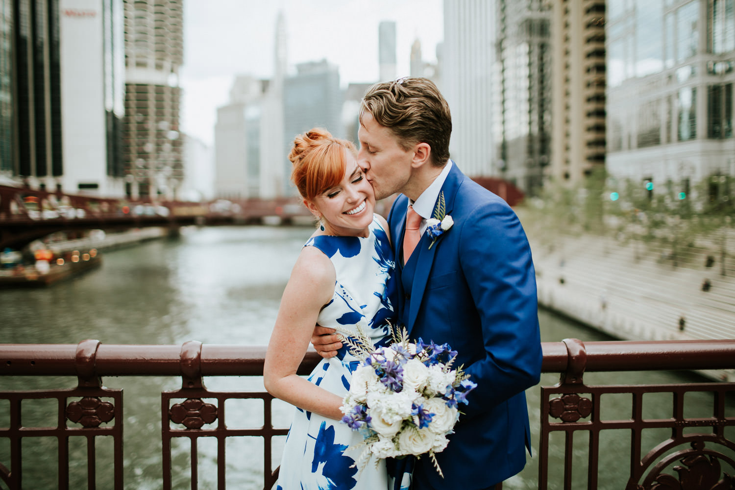 picture of the bride and groom taken on the bridge in down town Chicago