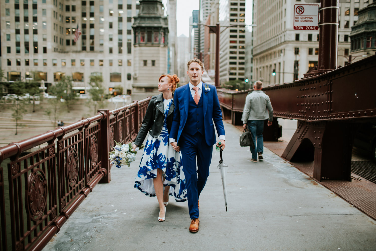 bride and groom explore Chicago downtown during their elopement
